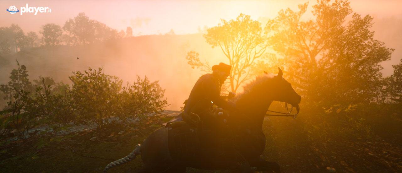 Red Dead Redemption II cavalcata durante il tramonto