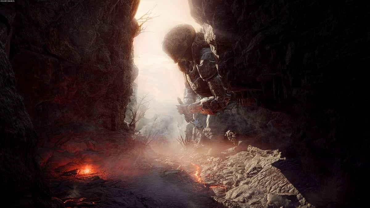 Screenshot di Anthem che raffigura una gola desertica con un'imponente statua umana