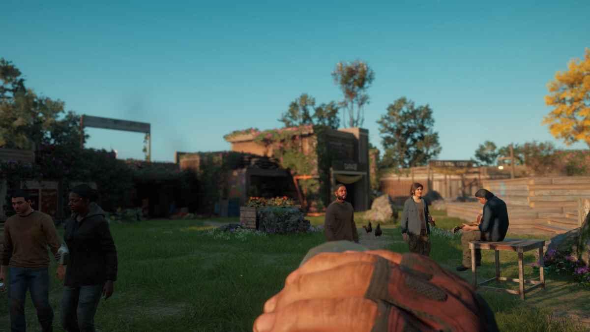 Screenshot da Far Cry: New Dawn che mostra una piccola festa tenuta nella Base Operativa di Prosperity