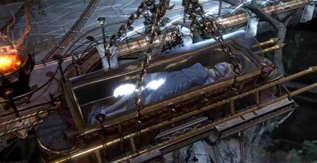 Kratos usa la bara di Persefone come un ariete per sfondare una statua di Ade