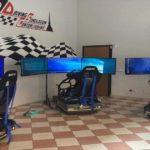 I tre rig del driving simulation center di Torino, composti da tre schermi ciascuno e la struttura del simulatore
