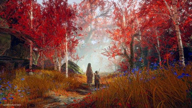 Atreus s'incammina in un paesaggio autunnale con la Strega del Bosco, ossia Freya