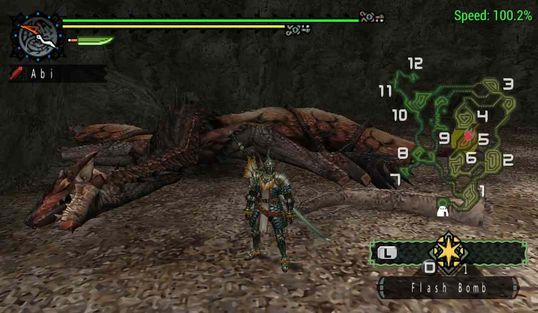 Uno screenshot dal primo Monster Hunter con un Rathalos morto alle spalle di un cacciatore