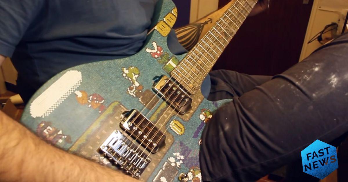 chitarra creata con i bastoncini dei lecca lecca