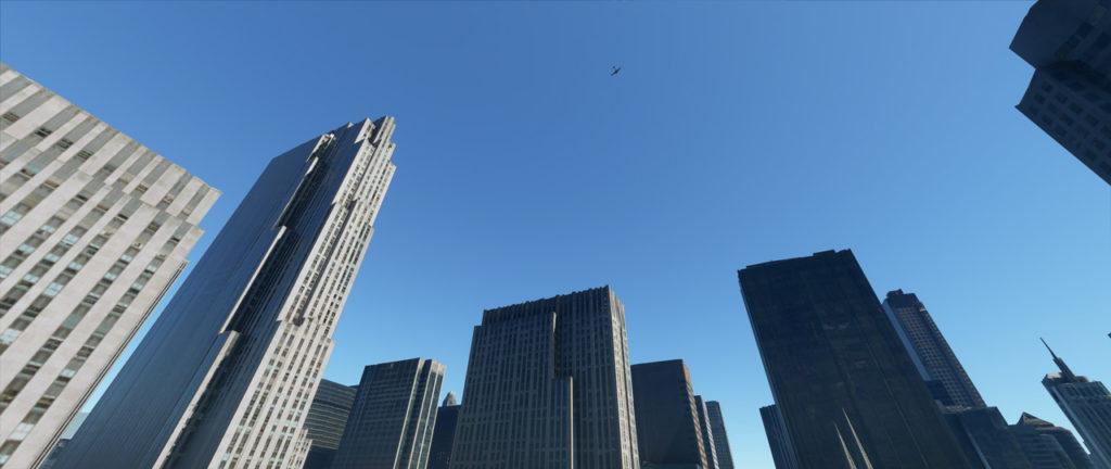 Microsoft Flight Simulator: vista dal basso dell'aereo che vola su New York